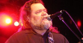 Roky Erickson via WikiCommons (Roky Erickson performing at the Austin Music Awards (2008). Photo by Ron Baker)